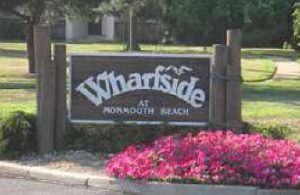 Wharfside Manor condo for sale Monmouth Beach sign